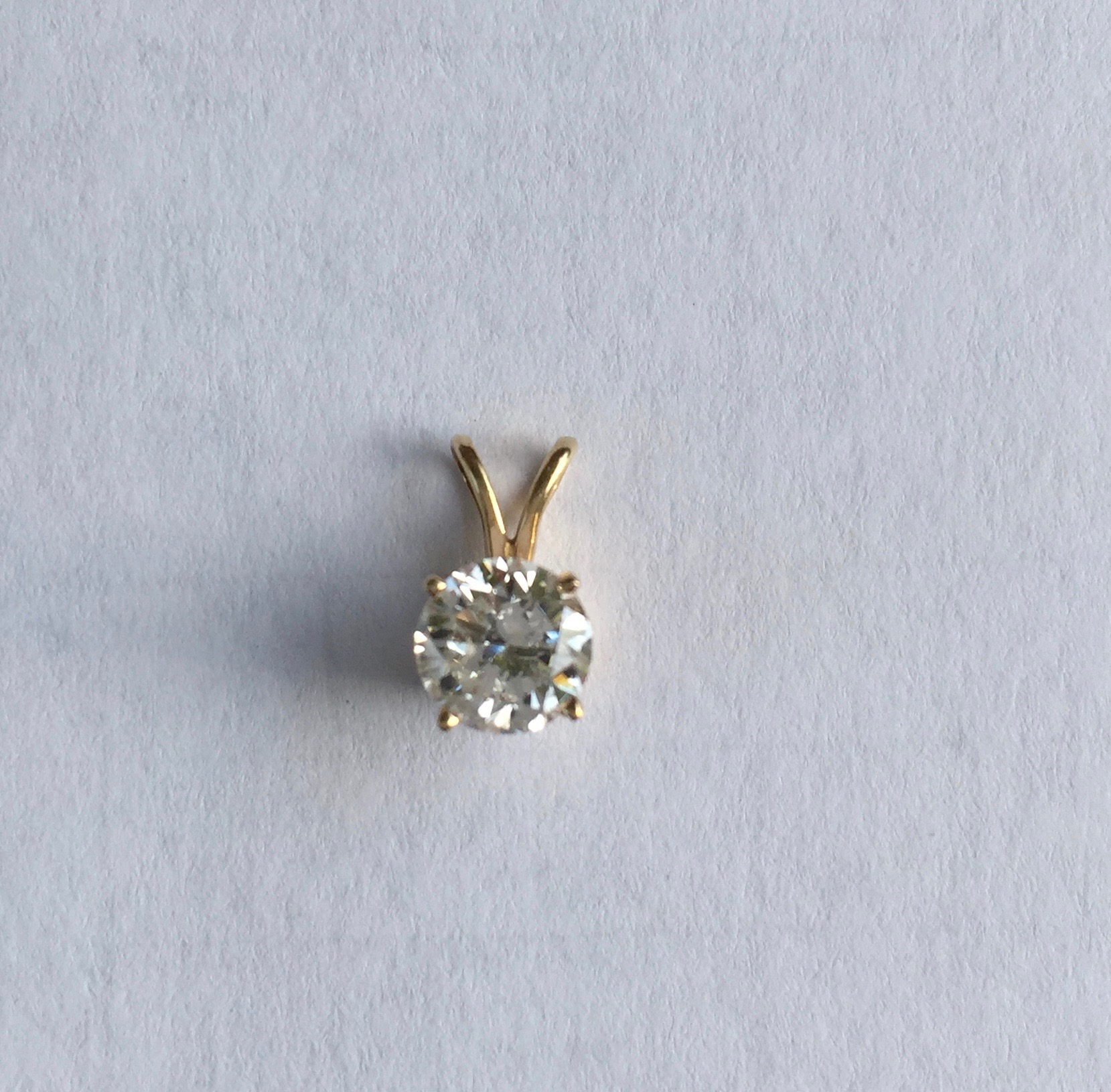 75ct. round diamond 14kt yellow gold rabbit ear bail necklace bling