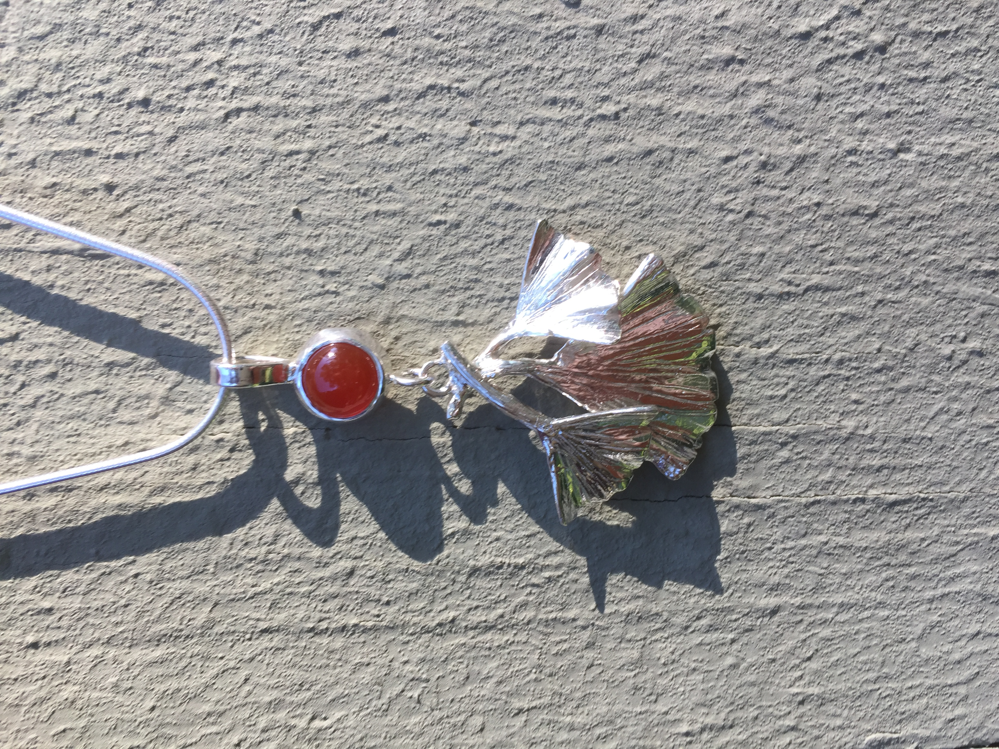 Red carnelian cabochon stone and silver gingko tree leaves necklace pendant