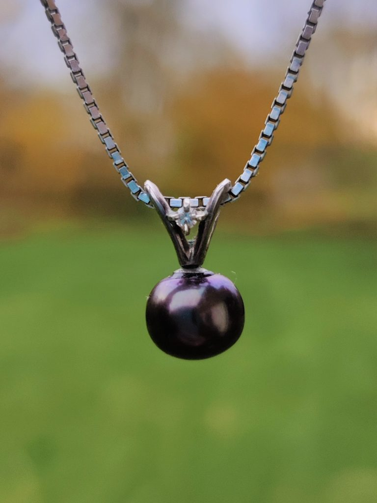 Black pearl and diamond gold necklace