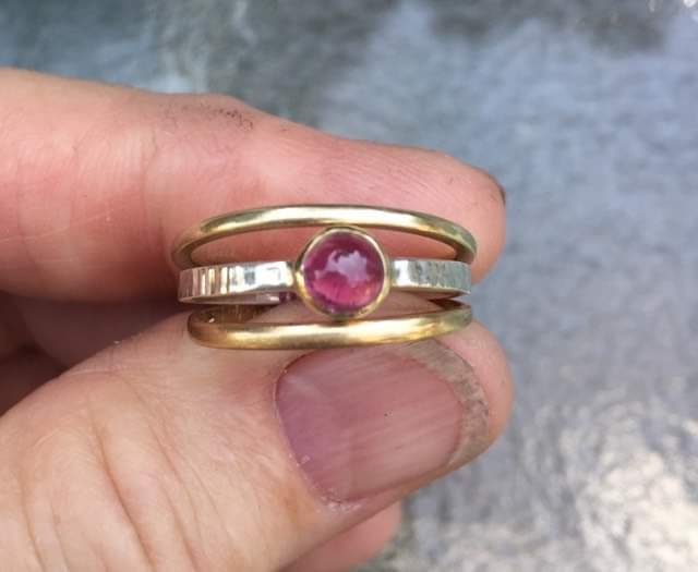 Stackable ring with pink tourmaline set in gold, on a silver ring