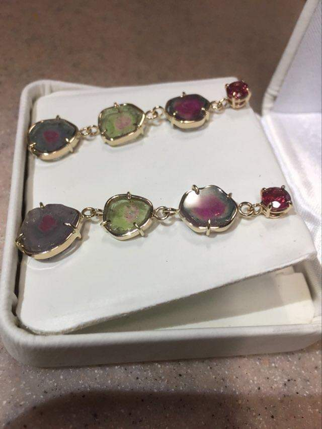 pink troumaline earrings with watermelon tourmaline slices in 14 yellow gold side view